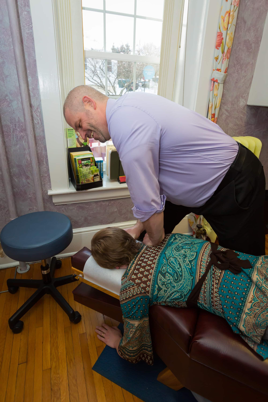 Dr. Sheehan adjusts a patient.